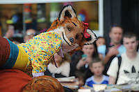 Pictured: Saturday 17 September 2016<br /> Re: Roald Dahl's City of the Unexpected has transformed Cardiff City Centre into a landmark celebration of Wales' foremost storyteller, Roald Dahl, in the year which celebrates his centenary.<br /> One of the flash mob performances on St Marys Street, Cardiff City centre.