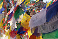 Bodhnath, Nepal.   Prayer Flags Decorate the Stupa.  The five colors represent the five elements: space, water, fire, air, and earth.