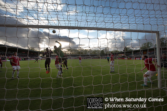FC United of Manchester 0 Benfica 1, 29/05/2015. Broadhurst Park, Stadium Opening. First-half action at Broadhurst Park, Manchester, the new home of FC United of Manchester during the first-half of the club's match against Benfica (in black shirts), champions of Portugal, which marked the official opening of their new stadium. FC United Manchester were formed in 2005 by fans disillusioned by the takeover of Manchester United by the Glazer family from America. The club gained several promotions and played in National League North in the 2015-16 season, but lost this match 1-0. Photo by Colin McPherson.