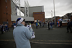 Blackburn Rovers 2 Aston Villa 0, 21/11/2010. Ewood Park, Premier League. Blackburn Rovers 2 Aston Villa 0, 21/11/2010. Ewood Park, Premier League. A souvenir seller holding Christmas-themed hats outside Ewood Park, home of Blackburn Rovers, before the club played host to Aston Villa in a Barclays Premier League match. Blackburn won the match by two goals to nil watched by a crowd of 21,848. It was Rovers' first match under the ownership of Indian company Venky's. Photo by Colin McPherson.