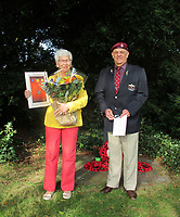 BNPS.co.uk (01202 558833)<br /> Pic: Chris Gryzelka/BNPS<br /> <br /> Touching ceremony - Willemien with Chris Gryzelka from the Para's veterans Association.<br /> <br /> Arnhem flowergirl finally honoured - Willemien was suprised to be presented with flowers and a certificate by Parachute Regiment veterans at the weekend.<br /> <br /> A Dutch woman who has tended to the grave of a British paratrooper killed at the Battle of Arnhem for 75 years has been presented with flowers from his regiment as a token of their gratitude.<br /> <br /> Every year Willemien Rieken, 84, lays flowers at Oosterbeek War Cemetery in memory of Trooper William Edmond who was shot by a German sniper after landing in Holland in World War Two.<br /> <br /> She was surprised at his grave by a member of Tpr Edmond's 1st Airborne Reconnaissance Squadron at a ceremony marking the 75th anniversary of the battle.