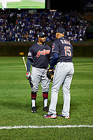 Cleveland Indians Rajai Davis (20) talks with Sandy Alomar (15) before Game 5 of the Major League Baseball World Series against the Chicago Cubs on October 30, 2016 at Wrigley Field in Chicago, Illinois.  (Mike Janes/Four Seam Images)
