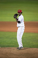 Orem Owlz relief pitcher Adalberto Pena (29) gets ready to deliver a pitch during a Pioneer League game against the Ogden Raptors at Home of the OWLZ on August 24, 2018 in Orem, Utah. The Ogden Raptors defeated the Orem Owlz by a score of 13-5. (Zachary Lucy/Four Seam Images)