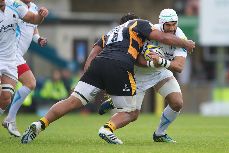 Blair Cowan of Worcester Warriors is tackled by Billy Vunipola of London Wasps during the Aviva Premiership match between London Wasps and Worcester Warriors at Adams Park on Sunday 7th October 2012 (Photo by Rob Munro)