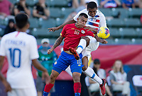 Reggie Cannon #2 of the United States and Randall Leal #10 of Costa Rica battle for a ball
