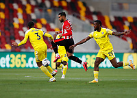 1st October 2020; Brentford Community Stadium, London, England; English Football League Cup, Carabao Cup Football, Brentford FC versus Fulham; Saman Ghoddos of Brentford is challenged by Michael Hector and Josh Onomah of Fulham