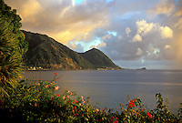 AJ2482, Dominica, island, paradise, Caribbean, Roseau, Caribbean Islands, Sunset along the scenic coast of the Caribbean Sea with its volcanic mountain range of the island of Dominica.