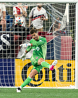 FOXBOROUGH, MA - JULY 7: Alex Bono #25 of Toronto FC clears the ball during a game between Toronto FC and New England Revolution at Gillette Stadium on July 7, 2021 in Foxborough, Massachusetts.