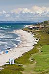 Denmark, Zealand, Kattegat Coast, Rageleje: Rageleje pebble beach with Swedish coastline in distance | Daenemark, Insel Seeland, Rageleje: Kieselsteinstrand am Kattegat, im Norden der Insel Seeland, am Horizont die schwedische Kueste