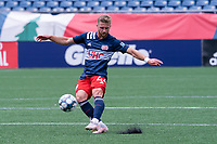 FOXBOROUGH, MA - JULY 4: Pierre Cacet #44 of the New England Revolution II passes the ball forward during a game between Greenville Triumph SC and New England Revolution II at Gillette Stadium on July 4, 2021 in Foxborough, Massachusetts.