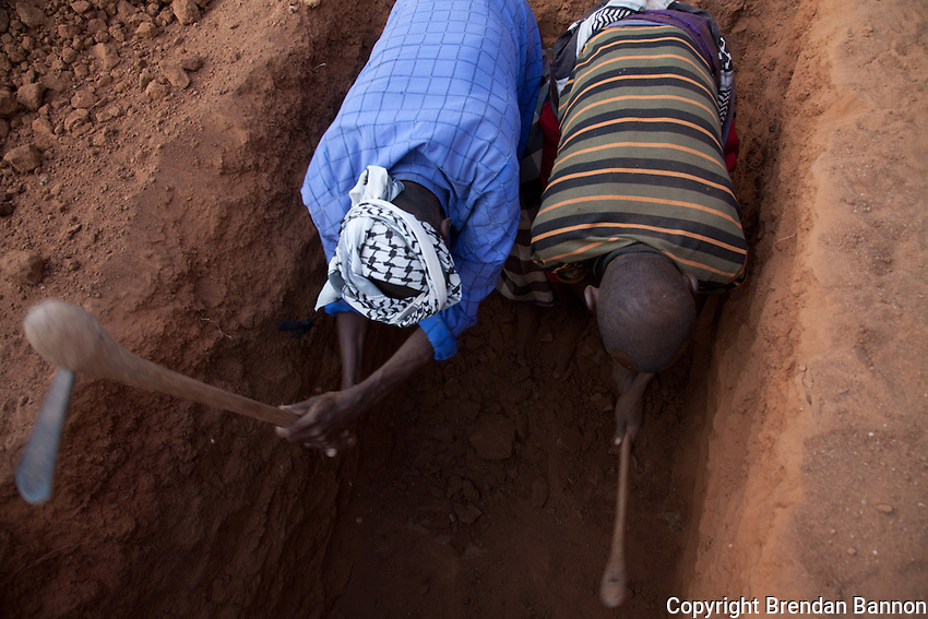 Volunteers dig a grave for a 60 year old refugee woman from Somalia. According to her uncle she arrived 3 weeks ago from Somalia and was exhausted from the journey and never recovered.