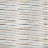Cane Weave, a hand-cut stone mosaic, shown in honed Cloud Nine , is part of the Tissé® collection for New Ravenna.