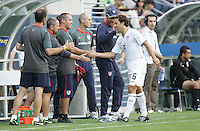 Steve Cherundolo shakes hands with USA staff as he comes off the field. USA defeated Grenada 4-0 during the First Round of the 2009 CONCACAF Gold Cup at Qwest Field in Seattle, Washington on July 4, 2009.