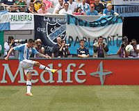 Argentina midfielder Jose Sosa (8) crosses the ball. In an international friendly (Clash of Titans), Argentina defeated Brazil, 4-3, at MetLife Stadium on June 9, 2012.