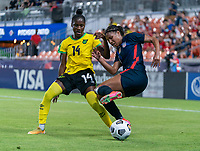 HOUSTON, TX - JUNE 13: Deneisha Blackwood #14 of Jamaica defends Margaret Purce #20 of the USWNT during a game between Jamaica and USWNT at BBVA Stadium on June 13, 2021 in Houston, Texas.