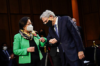WASHINGTON, DC - FEBRUARY 22:  (L-R) United States Senator Mazie Hirono (Democrat of Hawaii) gives an arm bump to Attorney General nominee Merrick Garland as they arrive for Garland's confirmation hearing before the Senate Judiciary Committee in the Hart Senate Office Building on February 22, 2021 in Washington, DC. Garland previously served at the Chief Judge for the U.S. Court of Appeals for the District of Columbia Circuit. <br /> Credit: Drew Angerer / Pool via CNP /MediaPunch