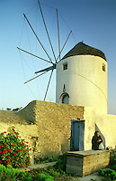 Windmill and tower for grinding grains in the courtyard of a private home. Santorini, Greece.