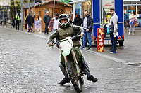Two young men riding on an unregistered motocross motorcycle  in Oxford Street, Swansea, Wales, UK. Monday 30 November 2020