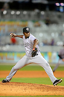 Jacksonville Suns pitcher Arquimedes Caminero #37 during a game against the Pensacola Blue Wahoos on April 15, 2013 at Pensacola Bayfront Stadium in Pensacola, Florida.  Jacksonville defeated Pensacola 1-0 in 11 innings.  (Mike Janes/Four Seam Images)