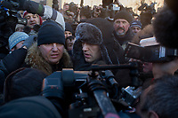 Russian opposition political activist Alexei Navalny speaks to reporters and prepares for his arrest during an unsanctioned anti-Putin demonstration in Lubyanka Square in central Moscow, Russia. Moments after this photo, police grabbed Navalny from the crowd and arrested him.  He was later released.  The protests come a year after protests in 2011 calling for fair elections and an end to corruption in Russia.  Navalny, a lawyer and political and economic activist, is known for his political blog on livejournal, which he has used to organize anti-corruption and anti-Putin demonstrations.