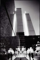 Reflection of people walking in front of the World Trade Center<br />