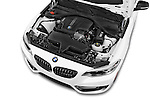 Car Stock 2015 BMW 2 Series 228I Sport 2 Door Coupe 2WD Engine high angle detail view