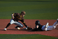 Jackson Gray (51) of the Western Kentucky Hilltoppers is tagged out attempting to steal second base by Valparaiso Crusaders second baseman Parker Johnson (18) at Nick Denes Field on March 19, 2021 in Bowling Green, Kentucky. (Brian Westerholt/Four Seam Images)