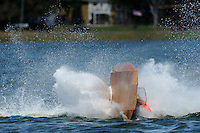 Frame 9: Bruce Hansen (44-W) blows over in a turn then turns upright after landing.....Stock  Outboard Winter Nationals, Ocoee, Florida, USA.13/14 March, 2010 © F.Peirce Williams 2010