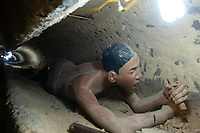 Vietnamese peasant doll in tunnel - Coconut Prison, Phu Quoc