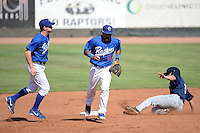 Ogden Raptors shortstop Dillon Moyer (5) and Jesmuel Valentin (6) run off the field as Helena Brewers Nathan Orf (3) is out on the play in action at Lindquist Field on July 21, 2013 in Ogden Utah. (Stephen Smith/Four Seam Images)