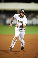 UCF Knights third baseman Kam Gellinger (3) running the bases during a game against the Siena Saints on February 17, 2017 at UCF Baseball Complex in Orlando, Florida.  UCF defeated Siena 17-6.  (Mike Janes/Four Seam Images)