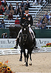 Peter Gmoser and Cointreau of Austria perform their Freestyle Dressage in the Grand Prix Freestyle Dressage competition at the Alltech World Equestrian Games in Lexington, Kentucky.
