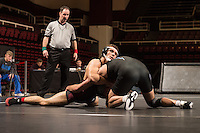 STANFORD, CA - January 18, 2015: Keaton Subjeck of the Stanford Cardinal wrestling team competes during a meet against Air Force Falcons at Maples Pavilion. Stanford won 27-8.