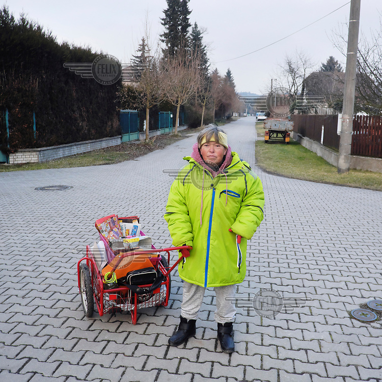 Milena (48), who distributes circular ads and supermarket flyers, with her cart.