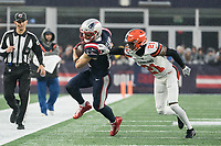 FOXBOROUGH, MA - OCTOBER 27: Cleveland Browns Cornerback Denzel Ward #21 pushes New England Patriots Wide Receiver Julian Edelman #11 near the sideline during a game between Cleveland Browns and New Enlgand Patriots at Gillettes on October 27, 2019 in Foxborough, Massachusetts.