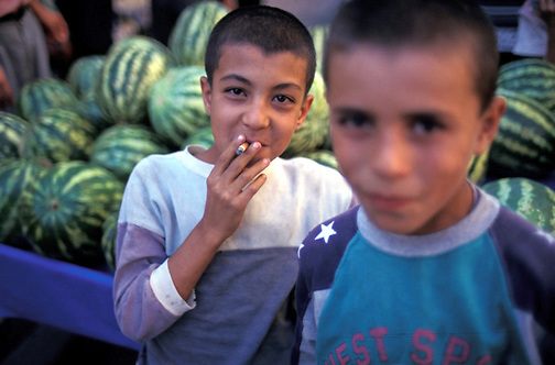 A young Kurdish boy smokes a Turkish cigarette in the streets of Diyarbakir in southeast Turkey. (Photo © September 1996 Pico van Houtryve)