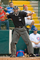 Home plate umpire Brandon Henson calls a batter out on strikes during a Florida State League game between the Dunedin Blue Jays and the Daytona Cubs at Jackie Robinson Stadium June 18, 2010, in Daytona Beach, Florida.  Photo by Brian Westerholt /  Seam Images