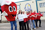 Pix: Shaun Flannery/shaunflanneryphotography.com...COPYRIGHT PICTURE>>SHAUN FLANNERY>01302-570814>>07778315553>>..29th June 2011..................The Topping Pie Company, Doncaster present a cheque for £2,000 to the British Heart Foundation (BHF), raised through a sponsored cycle ride..Pictured with the BHF mascot Mr Hearty are L-R Lynda Povey, General Manager of Toppings, Jean Spence of BHF, Jenny Le Couilliard of BHF, Laura Rae of Toppings, Julie Huxtable of Toppings, Derek Spence of BHF, Rod Couilliard of BHF.