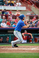 Hartford Yard Goats first baseman Brian Mundell (15) follows through on a swing during a game against the Erie SeaWolves on August 6, 2017 at UPMC Park in Erie, Pennsylvania.  Erie defeated Hartford 9-5.  (Mike Janes/Four Seam Images)