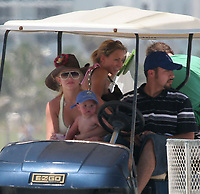 MIAMI BEACH, FL - JUNE 08 2006: Pop star Britney Spears  rides again with no car seat but this time on a golf cart in Miami beach and her baby Sean Preston Federline (b. 14-Sep-2005) on one hand and a drink in the other hand. on June 8, 2006 in Miami Beach, Florida. <br /> <br /> People;  Britney Spears; Sean Preston Federline
