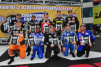 Sept. 16, 2011; Concord, NC, USA: NHRA top fuel dragster championship contender drivers (front row from left) Spencer Massey , Antron Brown , Del Worsham , Brandon Bernstein , Shawn Langdon (back row from left) Larry Dixon , Tony Schumacher , Doug Kalitta , Morgan Lucas and David Grubnic pose for a group photo during qualifying for the O'Reilly Auto Parts Nationals at zMax Dragway. Mandatory Credit: Mark J. Rebilas-US PRESSWIRE