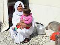 Iraq 2015 <br /> In the camp of Berseve, a Yazidi woman with a child near their tent <br /> Irak 2015 <br /> Au camp de Berseve, une femme yezidi et un enfant devant leur tente