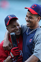 Erick Aybar #2 of the Los Angeles Angels greets Esmil Rodgers #32 of  the Cleveland Indians before a game at Angel Stadium on August 14, 2012 in Anaheim, California. Los Angeles defeated Cleveland 9-6. (Larry Goren/Four Seam Images)