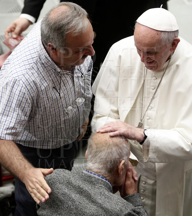 Papa Francesco benedice un uomo al termine dell'Udienza Generale del mercoledi' in aula Paolo VI, Citta' del Vaticano, 7 dicembre 2016.<br /> Pope Francis blesses a man at the end of his weekly general audience in Paul VI Hall at the Vatican on December 7, 2016. <br /> UPDATE IMAGES PRESS/Isabella Bonotto<br /> <br /> STRICTLY ONLY FOR EDITORIAL USE
