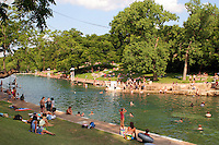 Swimming is popular year round at Barton Springs Swimming Pool in Austin, Texas, USA