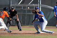Chicago Cubs first baseman Kelvin Freeman (18) takes a pick off attempt throw as Randy Ortiz (32) gets back to the bag during an Instructional League game against the San Francisco Giants on October 18, 2013 at Giants Baseball Complex in Phoenix, Arizona.  (Mike Janes/Four Seam Images)