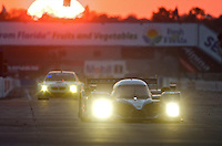 The sun sets on a pair of race cars during the 12 Hours of Sebring, Sebring, FL, MArch 20, 2010.  (Photo by Brian Cleary/www.bcpix.com)
