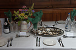 The annual Colchester Opening of the Colne Oyster Fishery, Brightlingsea, Essex. 2021<br /> An native oyster lunch is being prepared aboard the Thistle. <br /> Native Oysters provided by Tom Haward of Richard Hayward Oysters, Tom is an eighth generation oysterman