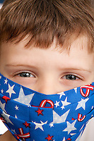Little Boy with fun medical mask with american flag desing