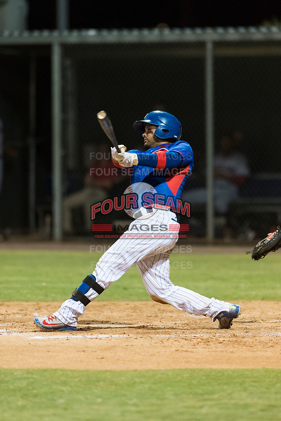 AZL Cubs 2 catcher Richard Nunez (2) swings at a pitch during an Arizona League game against the AZL Indians 2 at Sloan Park on August 2, 2018 in Mesa, Arizona. The AZL Indians 2 defeated the AZL Cubs 2 by a score of 9-8. (Zachary Lucy/Four Seam Images)